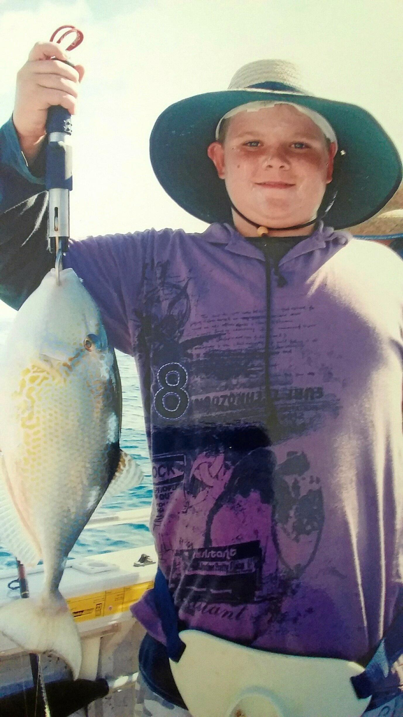TRIGGER HAPPY: Korey McLaughlin aged 13 with his first fish (a big trigger fish) ready for release. Happy birthday Korey.