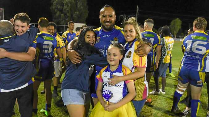 WELL DONE: The Waves' coach Antonio Kaufusi celebrates the grand final win against the Wallaroos with his family at Salter Oval on Saturday night.