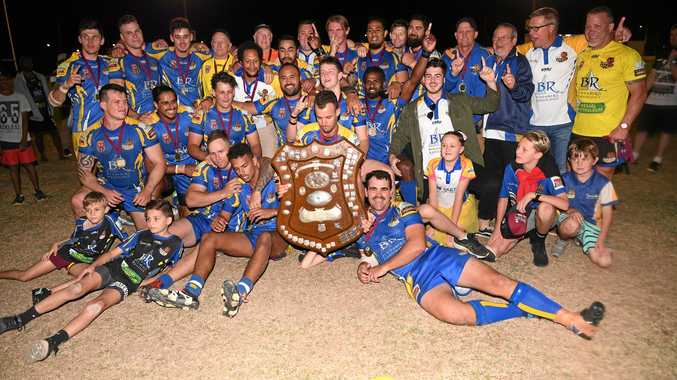 CHAMPIONS: The Waves players, coaches and junior celebrate the A-grade win.