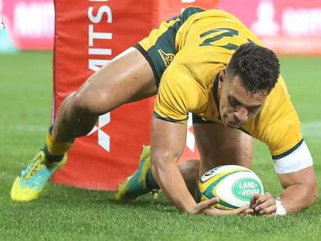 Matt Toomua of the Wallabies scores a try during the match against South Africa at Suncorp Stadium. Picture: Getty Images
