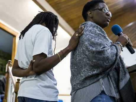 Allison Jean, the mother of Botham Jean, she is comforted by her daughter during a prayer vigil for her son at the Dallas West Church of Christ.
