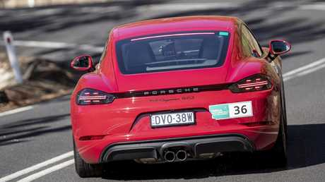 Porsche Cayman GTS' 20-inch wheels are wrapped in Michelin Pilot Sport 4 S tyres.