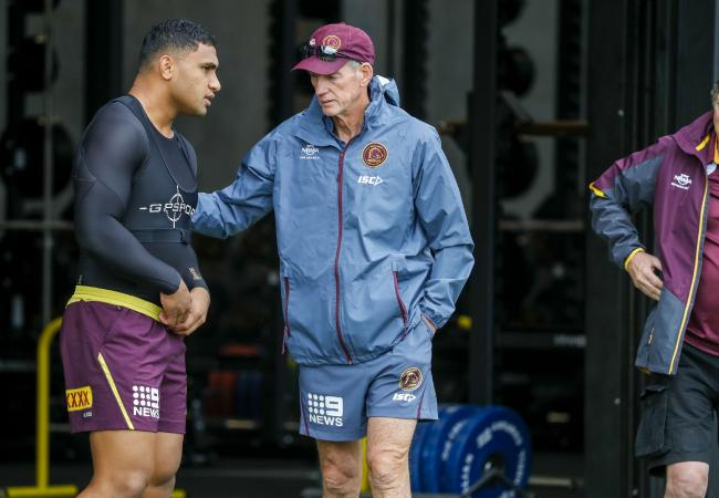 Brisbane Broncos player Joe Ofahengaue (left) speaks with coach Wayne Bennett.