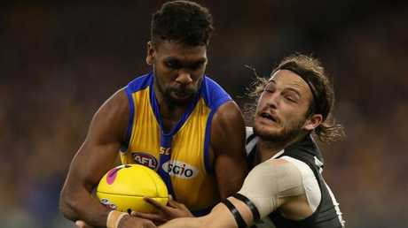 Liam Ryan tries to break a James Aish tackle on Saturday night. Picture: Getty Images