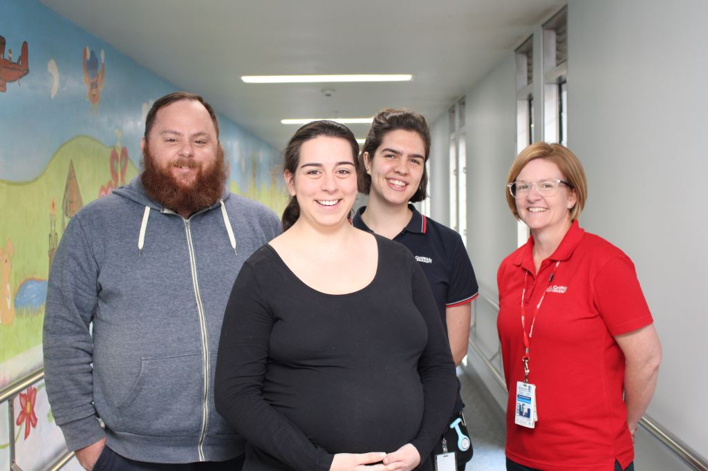 Expectant mother Laura Andrews, and her husband Cameron Andrews, along with (back from left) student midwife Monique Matthews and midwifery lecturer/fully credentialed midwife, Karen McDonald-Smith.