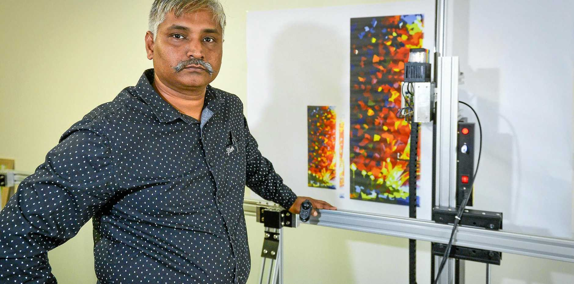 EPIC BUSINESS IDEA: Dinesh Salaria owns Epic Wall Printers, a vertical printing business in Gladstone, and can do innovative designs to suit customers' requirements.