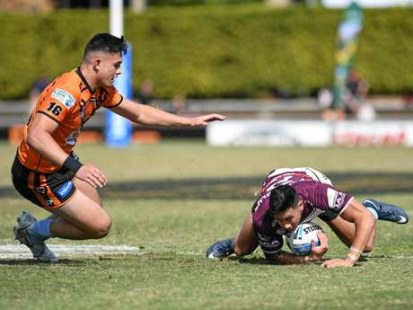 CHARGE IN: Gympie's Tino Fa'asuamaleaui goes to make the tackle on the Burleigh Bears player.