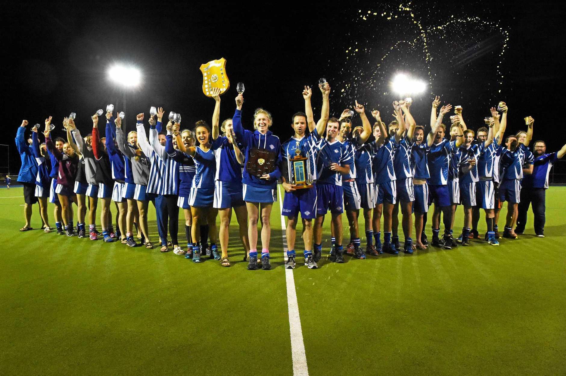 THE DOUBLE: Wallaroos men and women celebrating winning both major premierships in 2018.