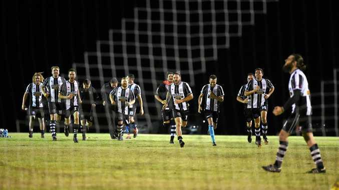 Bingera celebrates the winning penalty. Wide Bay Premier League major semi final: Doon Villa v Bingera at Bingera Grounds.