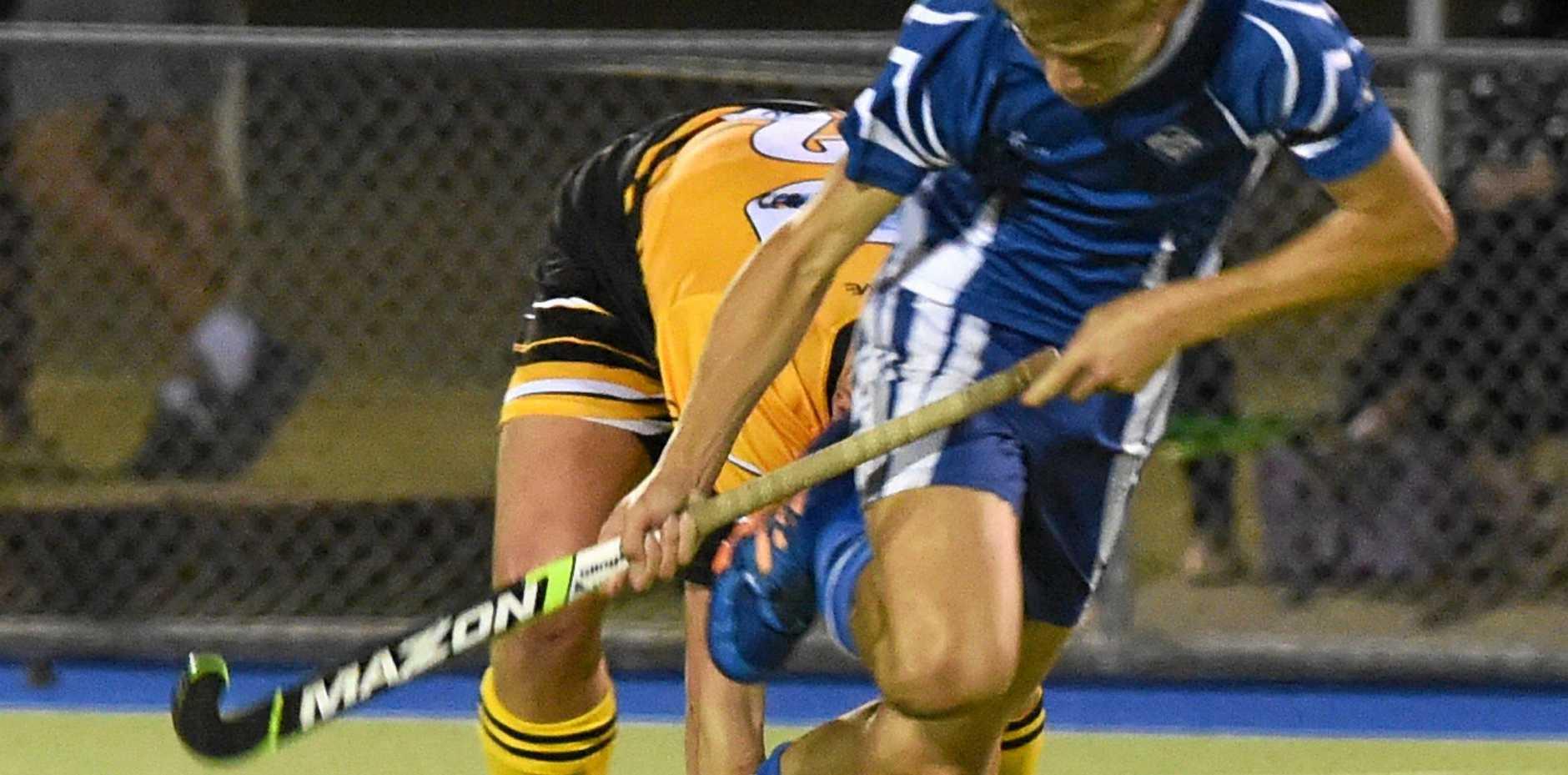 GOTCHA: Granville's Blake Kroning makes a tackle on Wallaroos goalscorer Jaspa Wright during the Maryborough Hockey Division 1 grand final.