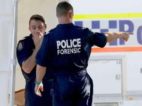 Forensic police officers investigated the scene overnight. Picture: Richard Wainwright/AAP