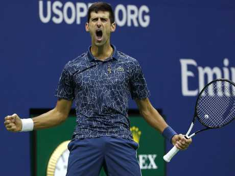 Novak Djokovic, of Serbia, reacts after breaking the serve of Juan Martin del Potro. Picture: AP Photo