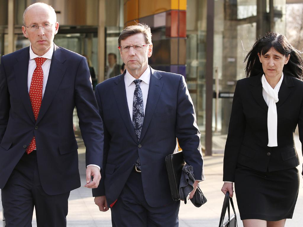 ClearView chief actuary and risk officer Greg Martin, centre, leaves the royal commission on Monday. Picture: AAP