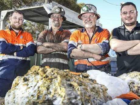 Geologist Lachlan Kenna, Henry Dole, foreman Warren Edwards and senior geologist Zaf Thanos with the 90kg gold specimen. Picture: Kelsey Reid