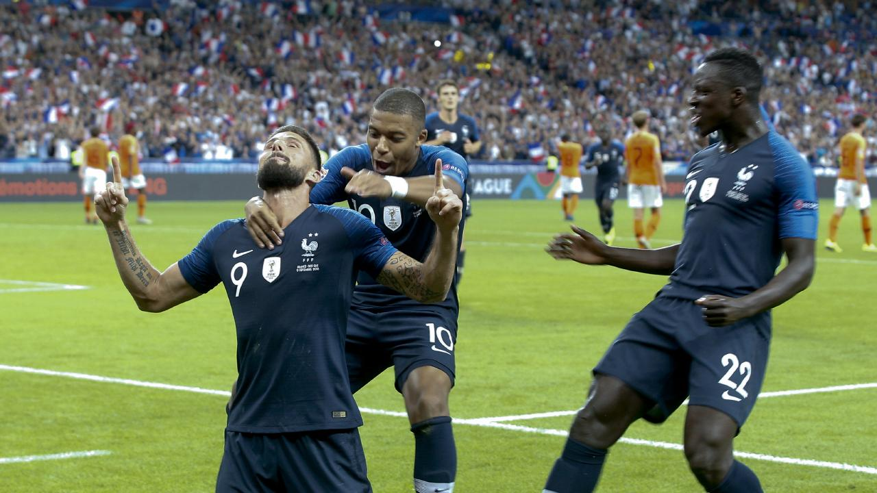 Olivier Giroud (left) of France celebrates with teammates after scoring against the Netherlands.