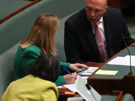 Home Affairs Minister Peter Dutton talking Rebekha Sharkie and Cathy McGowan in Question Time in the House of Representatives chamber, Parliament House in Canberra. Picture Kym Smith
