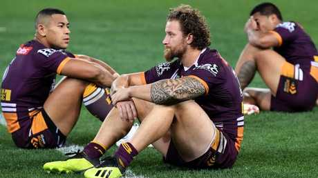 Broncos players Jamayne Isaako, Korbin Sims and Anthony Milford are dejected. Photo: AAP