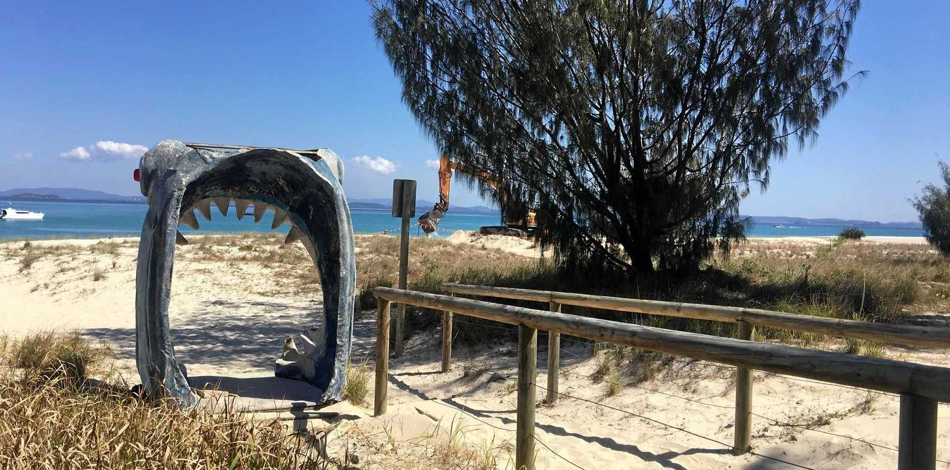 DUNES GOING: Sand dunes are being dug up close to shops and walkways on Fisherman's Beach on Great Keppel Island to use for sandbags on Putney Beach to save Great Keppel Island Hideaway and Putney Beach.