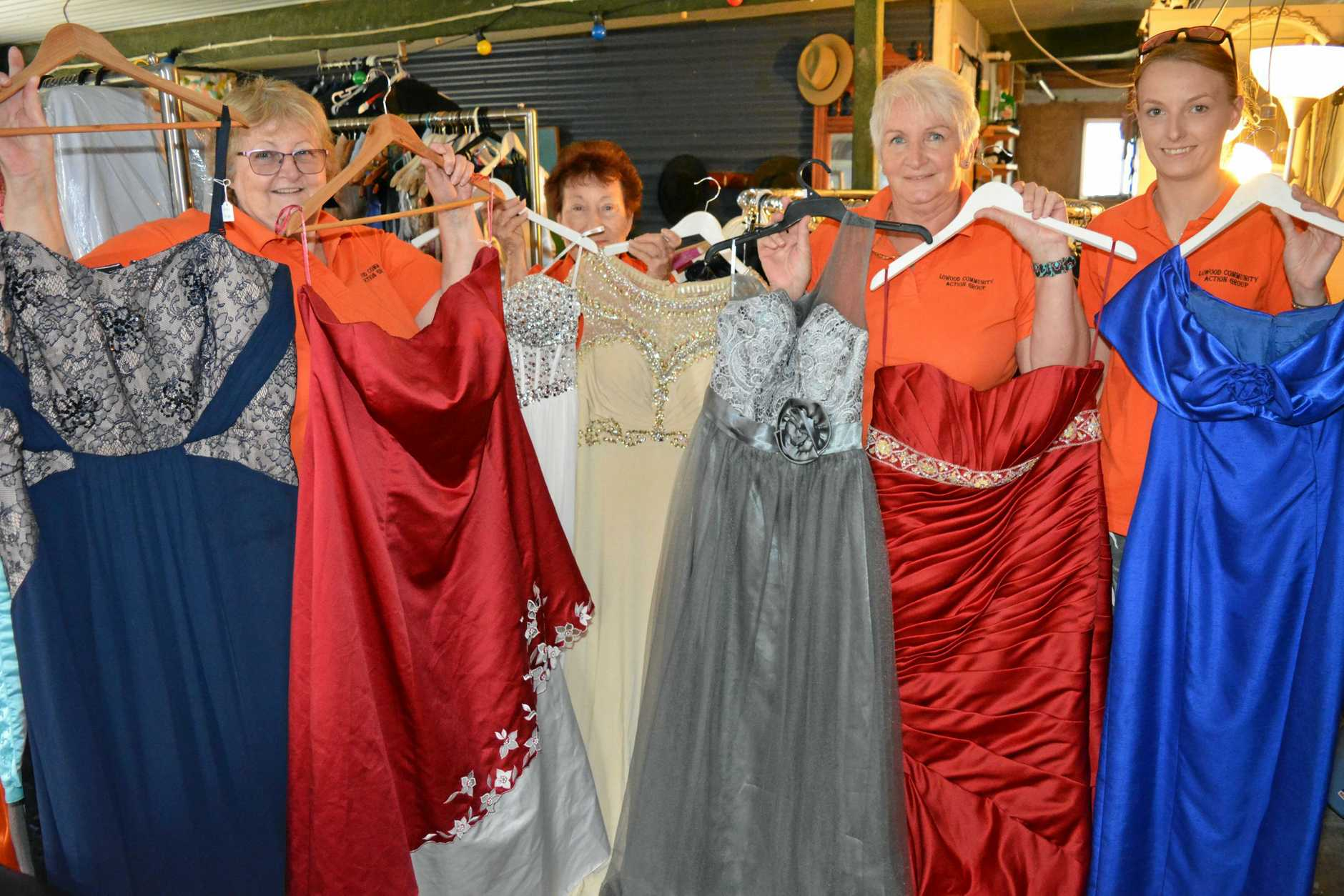 Pauline, Kaitlin, Sue and Joy from the Lowood Community Action Group show off some of the formal wear donations.