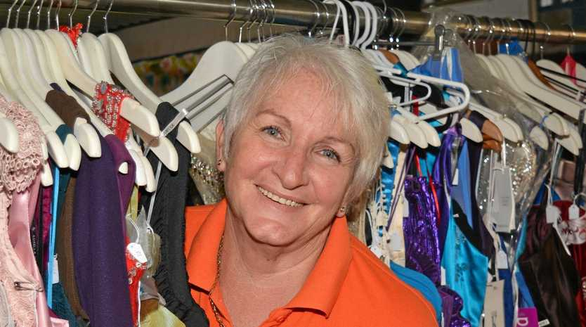 SUIT UP: Lowood Community Action Group president Sue Fraser is overwhelmed by the amount of formal wear donated to the cause.