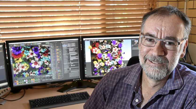 ANIMATION FASCINATION: Animator John Rowe in his Toowoomba office where he has been creating a new animation feature for the Carnival of Flowers and LIT Festival to be held later this month.