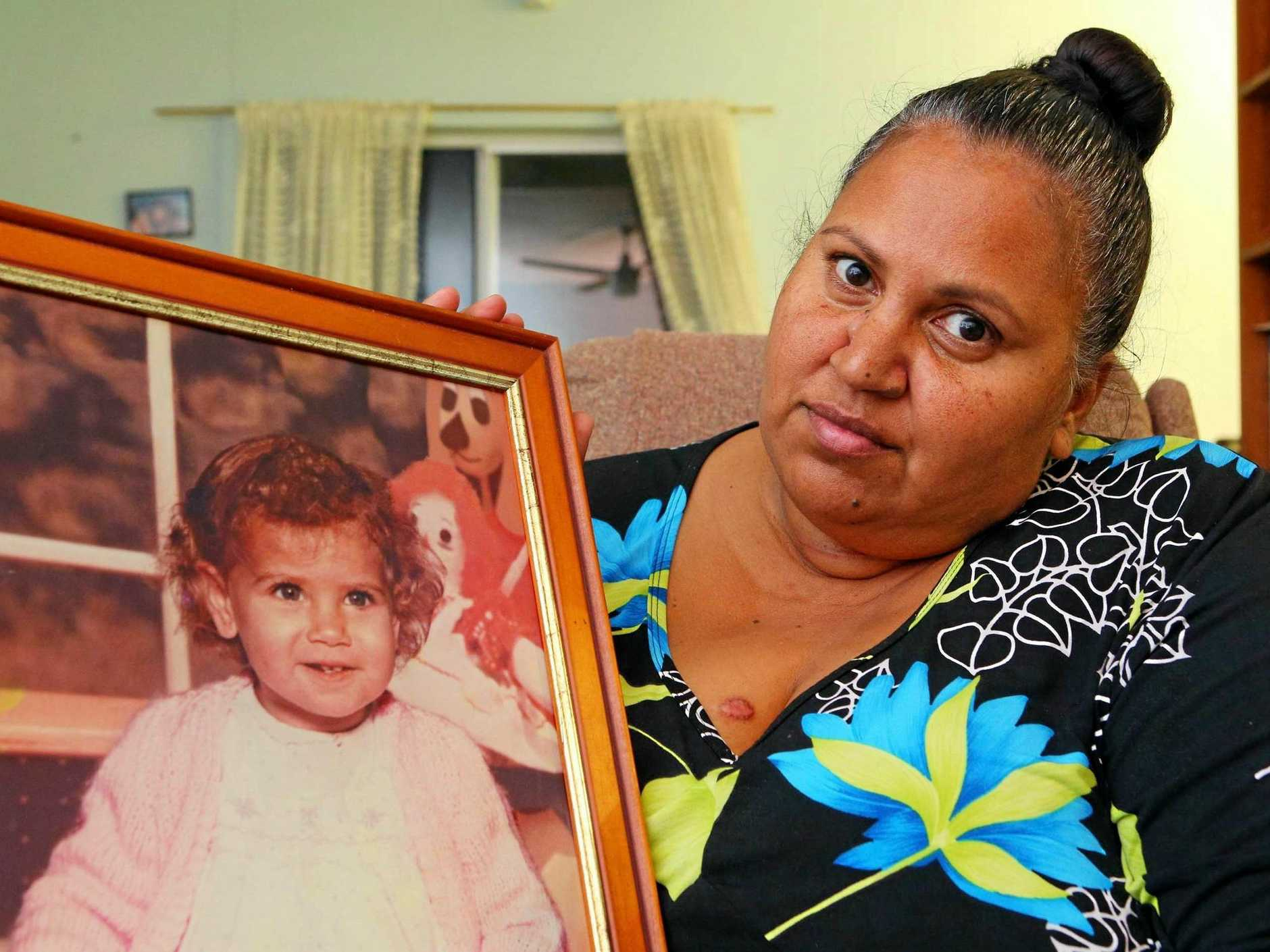 FIGHTING FOR JUSTICE: Michelle Jarrett with a photo of her niece Evelyn Greenup, one of the three Aboriginal children murdered in Bowraville 26 years ago.