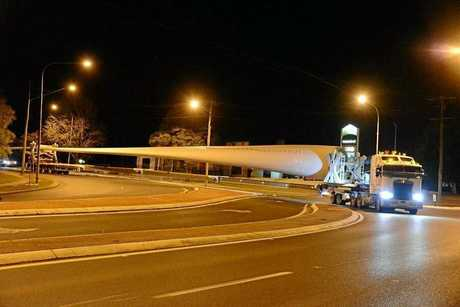 The first blade for AGL's Coopers Gap Wind Farm makes its way along the highway through Toowoomba.