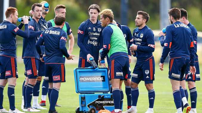 TRAINING:  Keisuke Honda takes a drink with teammates during a Melbourne Victory training session at Gosch's Paddock in Melbourne.