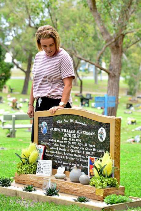 Sonya Ackerman at James Ackerman's grave in Caloundra.