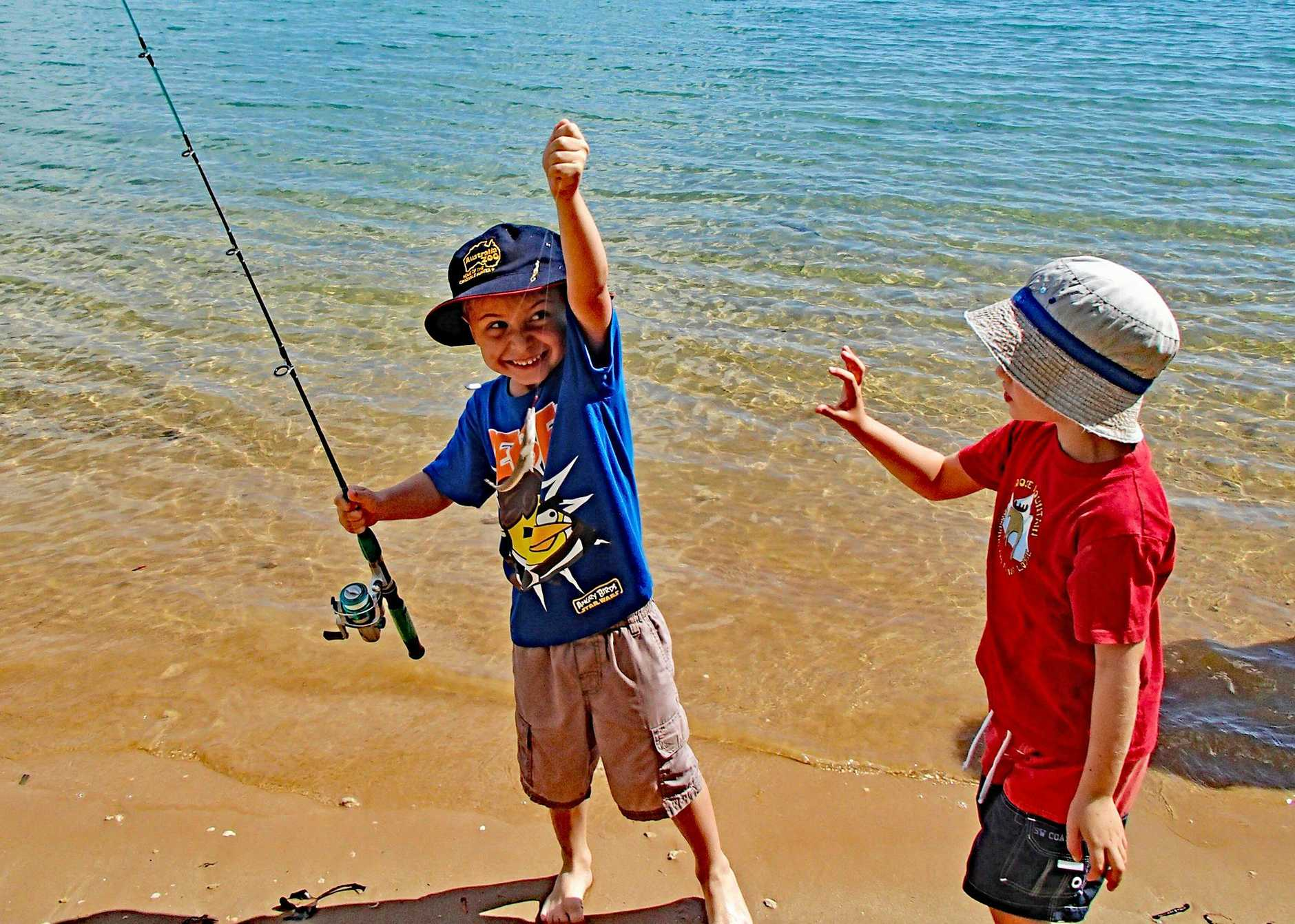 REEL EM' IN: Young anglers Harry Service and Sonny Phillips cast a line at Fixter Park in the hope of snapping up a prize at last year's Toogoom Fishing Competition.