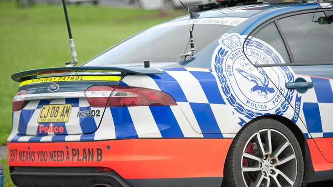 A driver who allegedly tried to ram a police car during a pursuit across the Tweed yesterday has been charged.