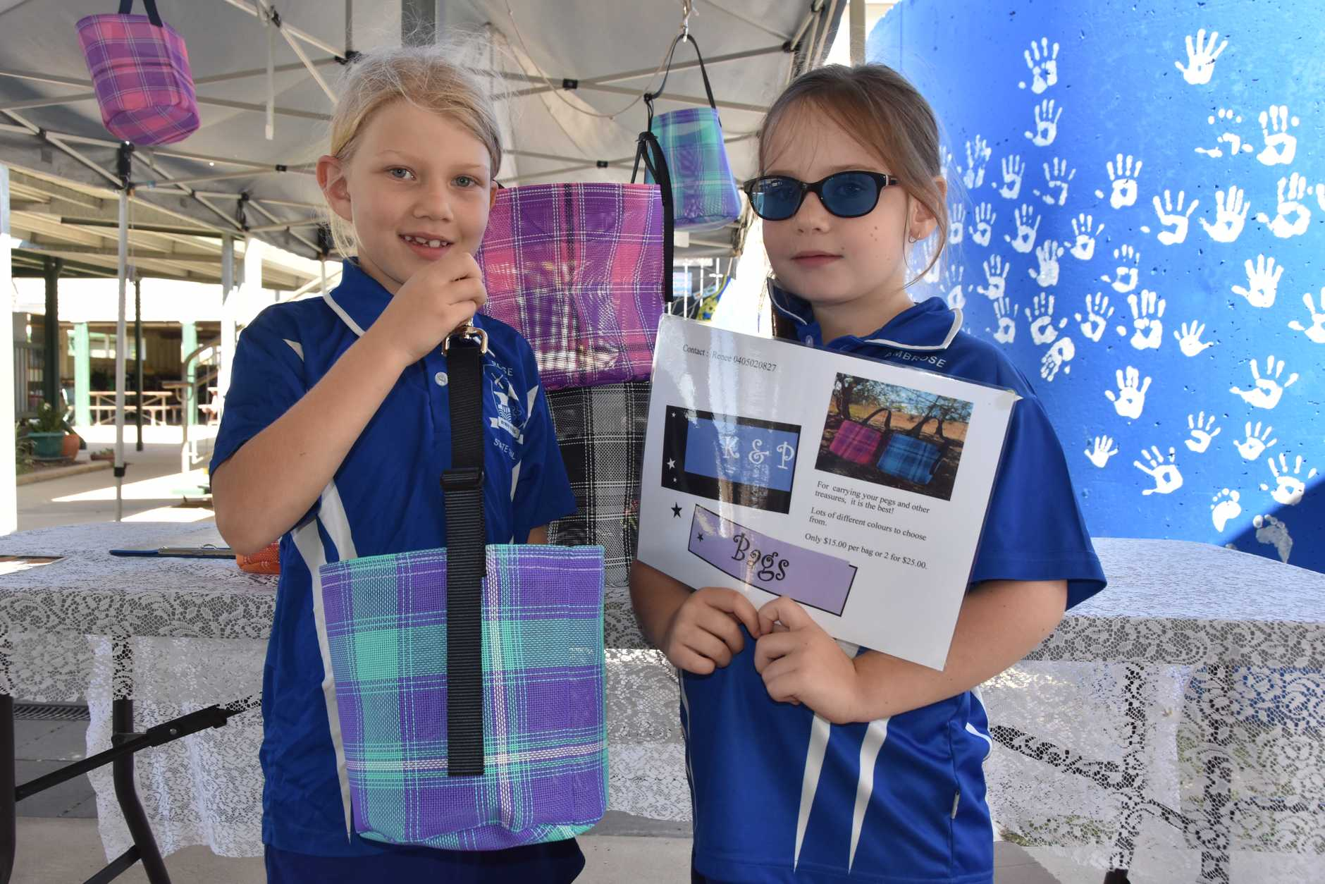 Katie Birthisel, 7 and Phoenix Watson, 7 with their amazing peg basket product.