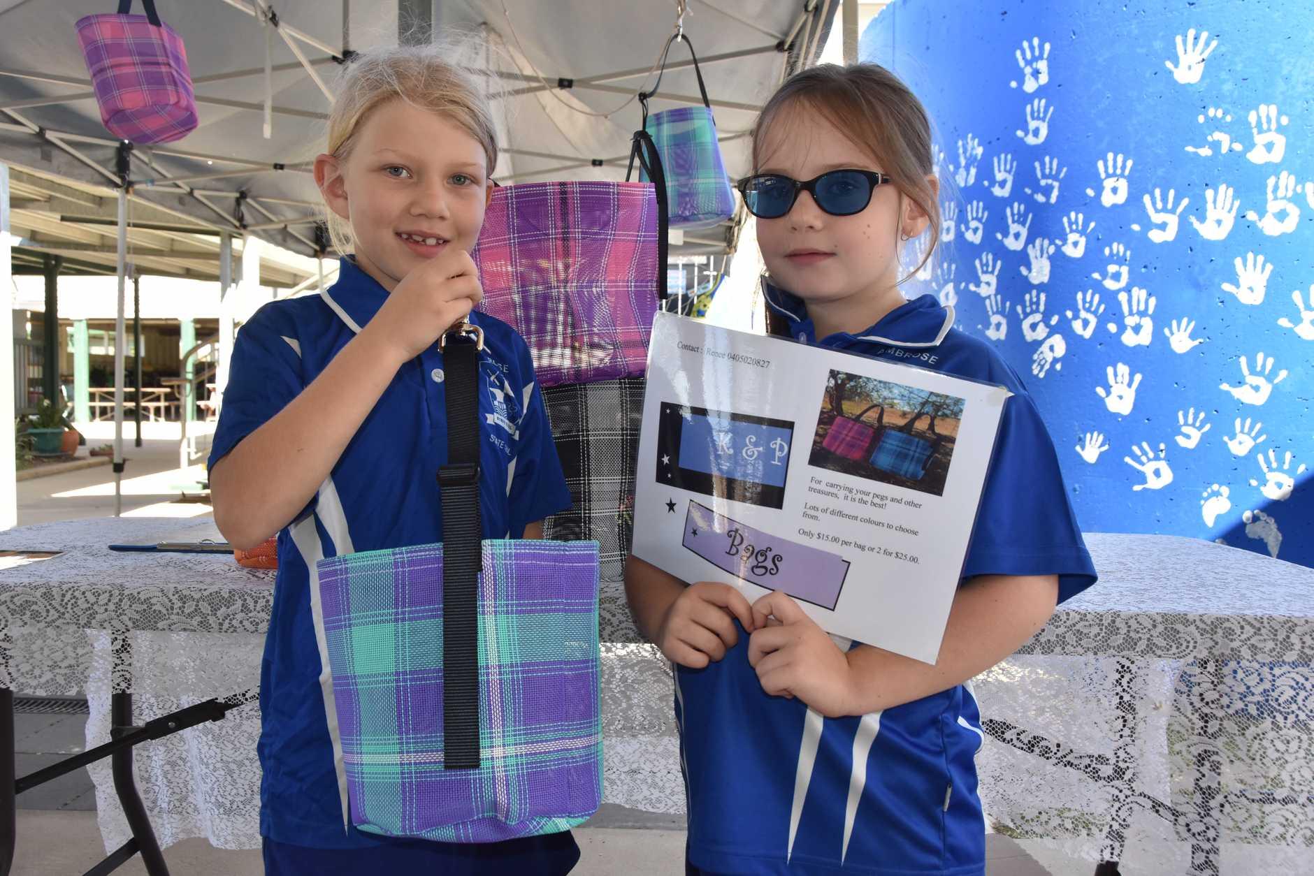 Katie Birthisel, 7 and Phoenix Watson, 7 with their amazing peg basket product.