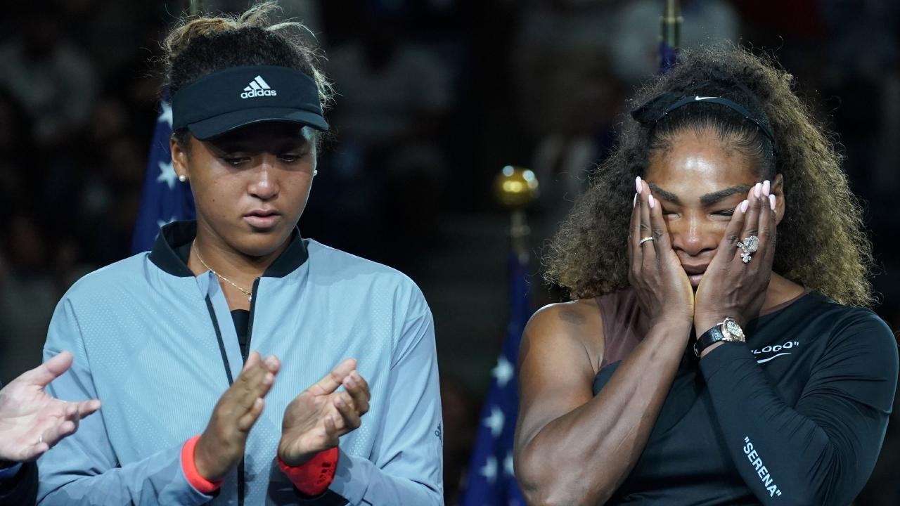 Naomi Osaka and Serena Williams during an emotional trophy ceremony. (Photo by TIMOTHY A. CLARY / AFP)