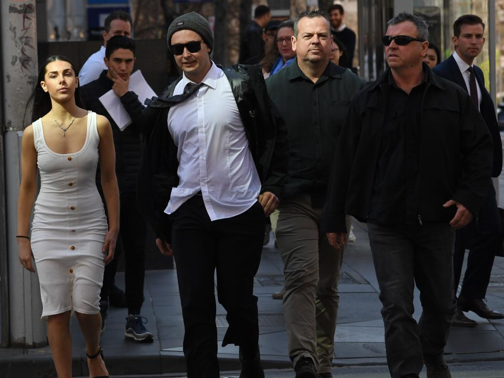 Brent Moresco leaves the County Court in Melbourne with supporters. Photo: AAP