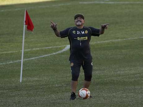 Former soccer great Diego Maradona dances on the pitch at the Dorados de Sinaloa soccer club stadium. (AP Photo/Marco Ugarte)