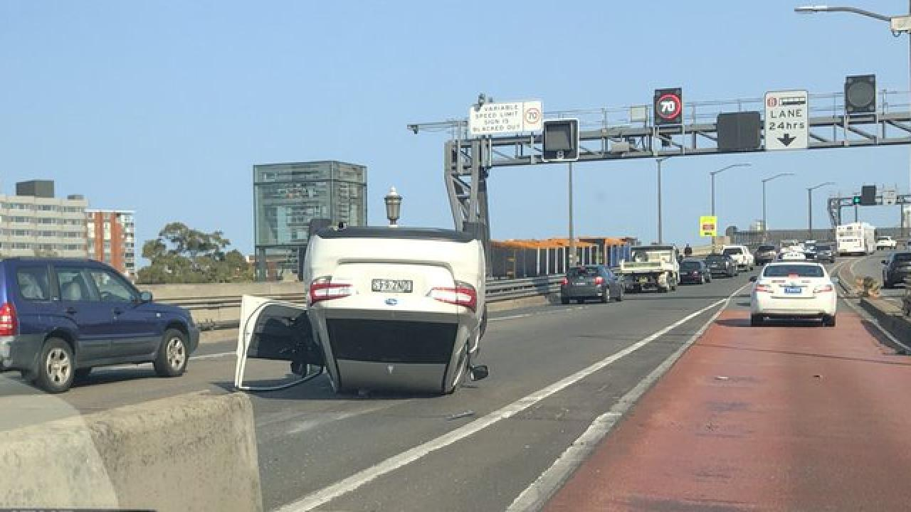A car flipped on Sydney Harbour Bridge. Source: Twitter @mfazackerley