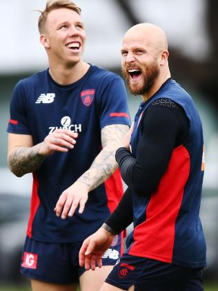 A happy Jones with teammate James Harmes at training this week. Pic: Getty Images