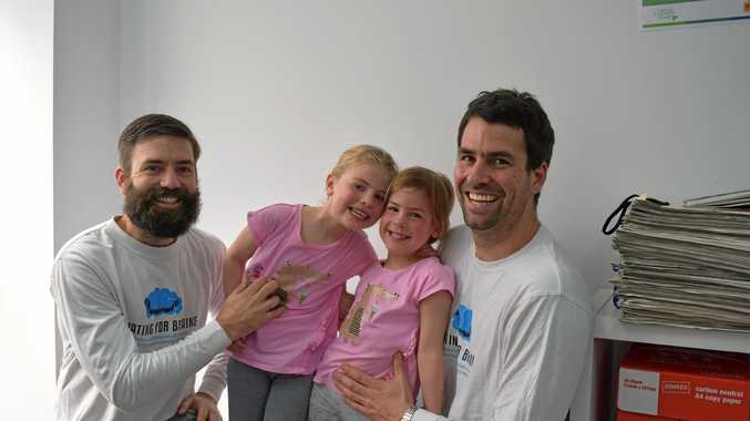 ALL GO: Robert (left) and Peter Christen have been busy training for their Boating For Brains Dragon Boat Journey fundraiser for the Neurology department at the Royal Children's Hospital in Melbourne. Pictured with the brothers are Peter's daughters Olivia, 6 and Amelia, 4.
