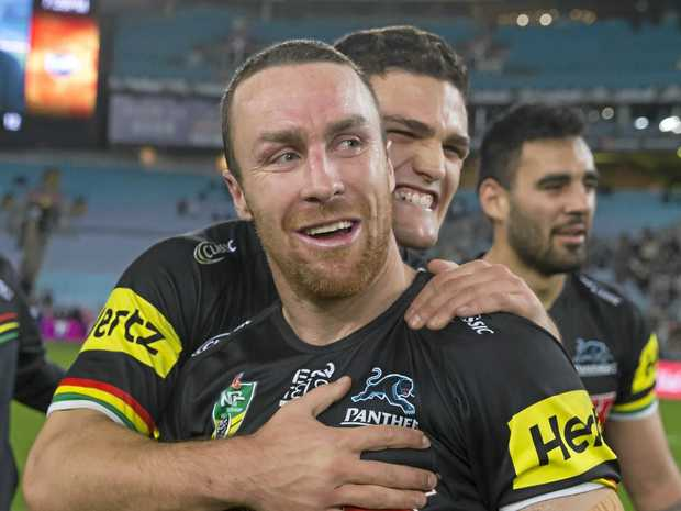 The Panthers' Nathan Cleary embraces James Maloney at full-time in last Saturday's elimination final against the Warriors. Picture: Craig Golding/AAP