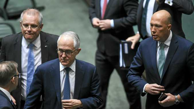 (L-R) Prime Minister Scott Morrison, former Australian Prime Minister Malcolm Turnbull and former Australian Home Affairs Minister Peter Dutton leave after a vote to refer former Australian Home Affairs Minister Peter Dutton to the High Court in the House of Representatives at Parliament House in Canberra, Thursday, August 23, 2018.