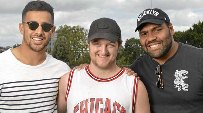 TEAM MATES: Participant Jesse meets NRL stars Jordan Kahu and Sam Thaiday at the Disability Action Week event 'Kick Start Spring'.