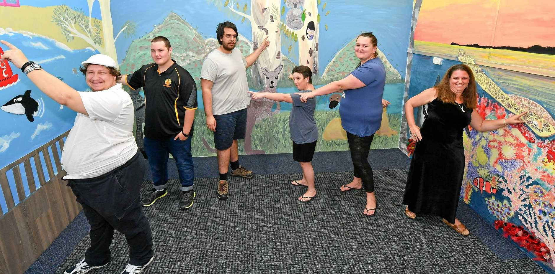 IN THE PICTURE: David Collins, Tristan Vickery, Jakib Holmes, Kendall MacBeath, Petica Langford and Angie Goodrem with the mural wall at Unique Quality Care.