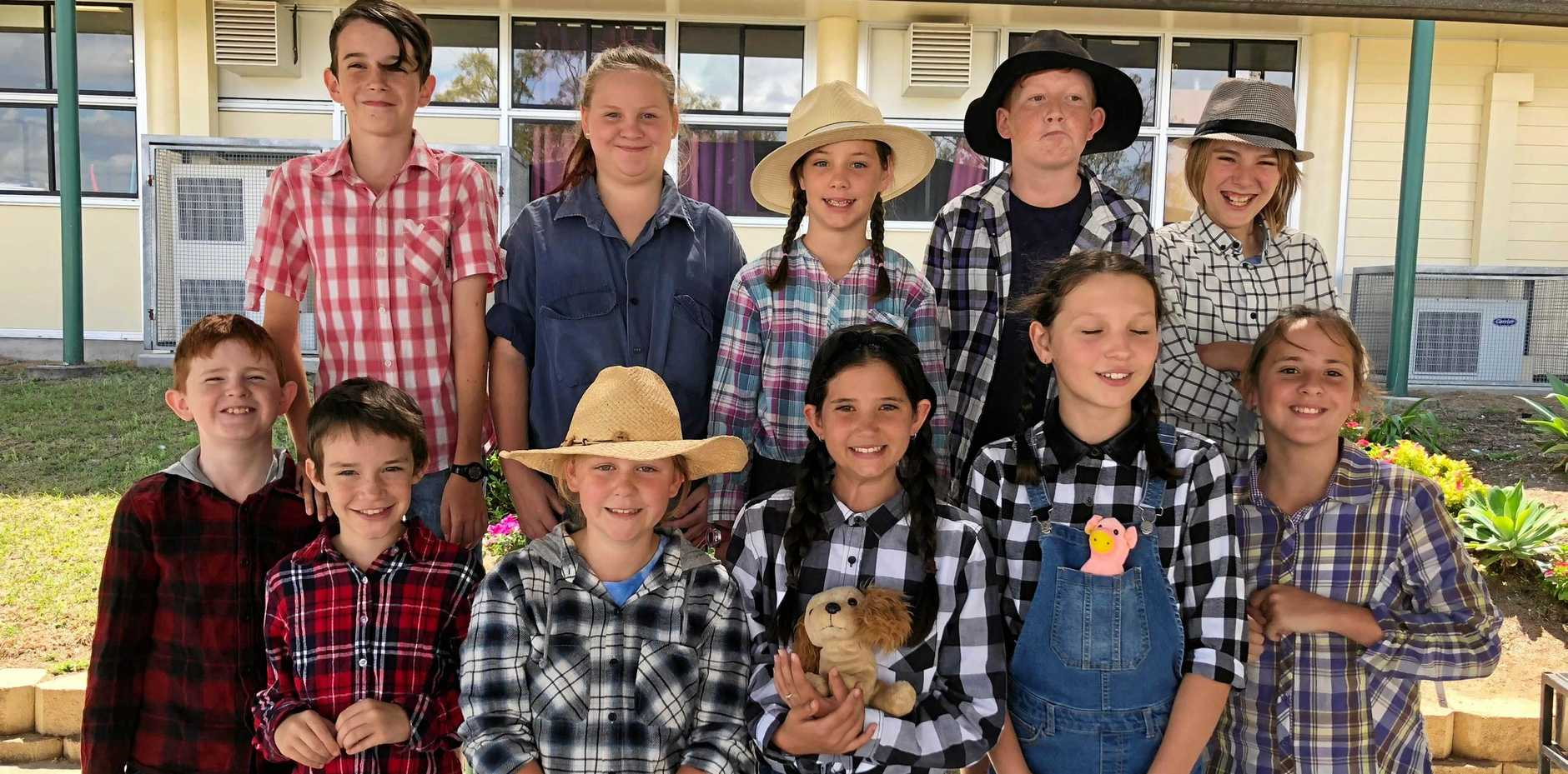 Charity Minded: Recently Kin Kora students hosted a farmer dress up gold coin donation to raise money for Drought Angels.