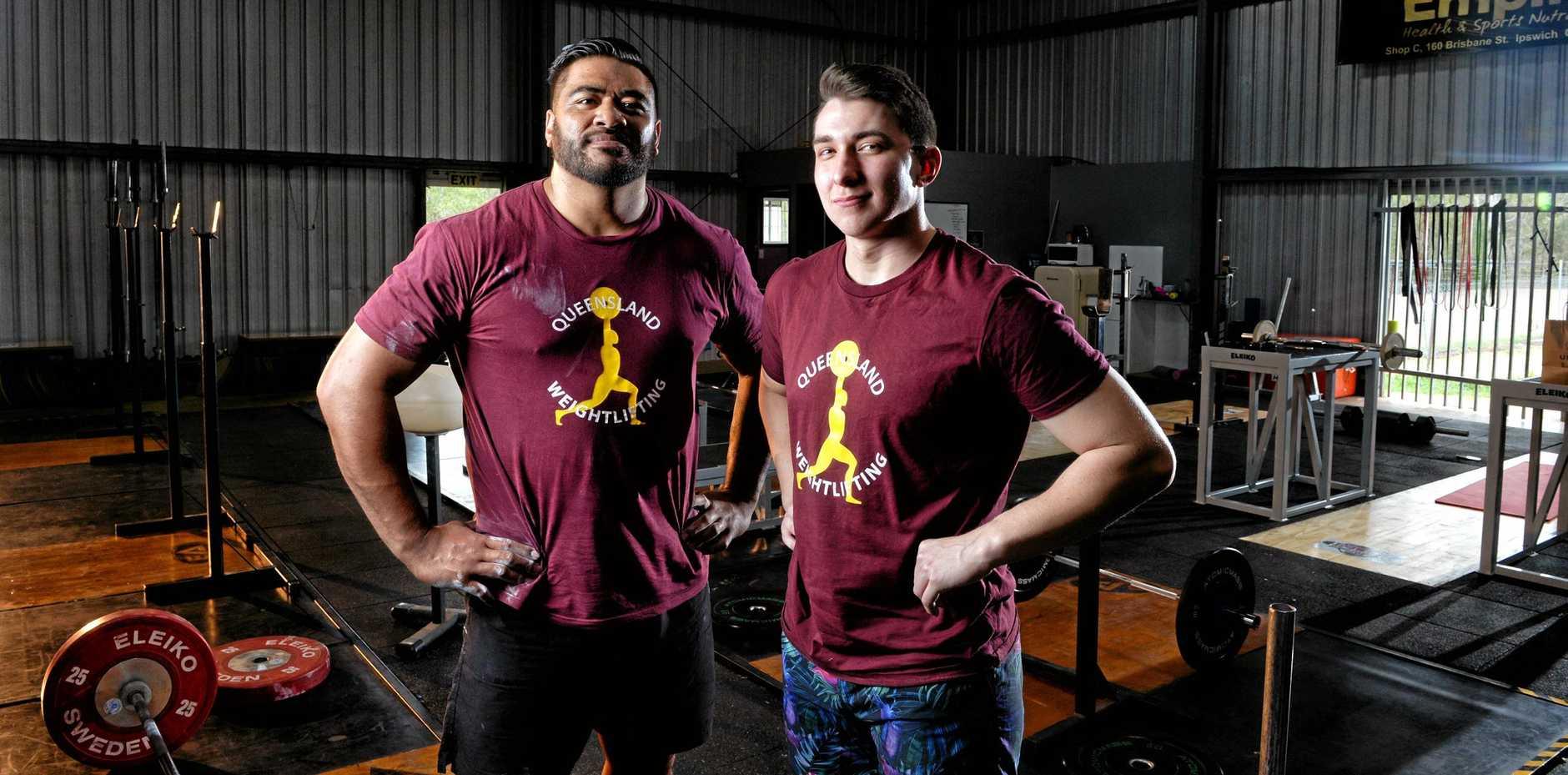 POWERFUL PARTNERSHIP: Jax Solofa and Braydan Fender of Ipswich Weightlifting Club are Australian Weightlifting Federation senior and junior champions.