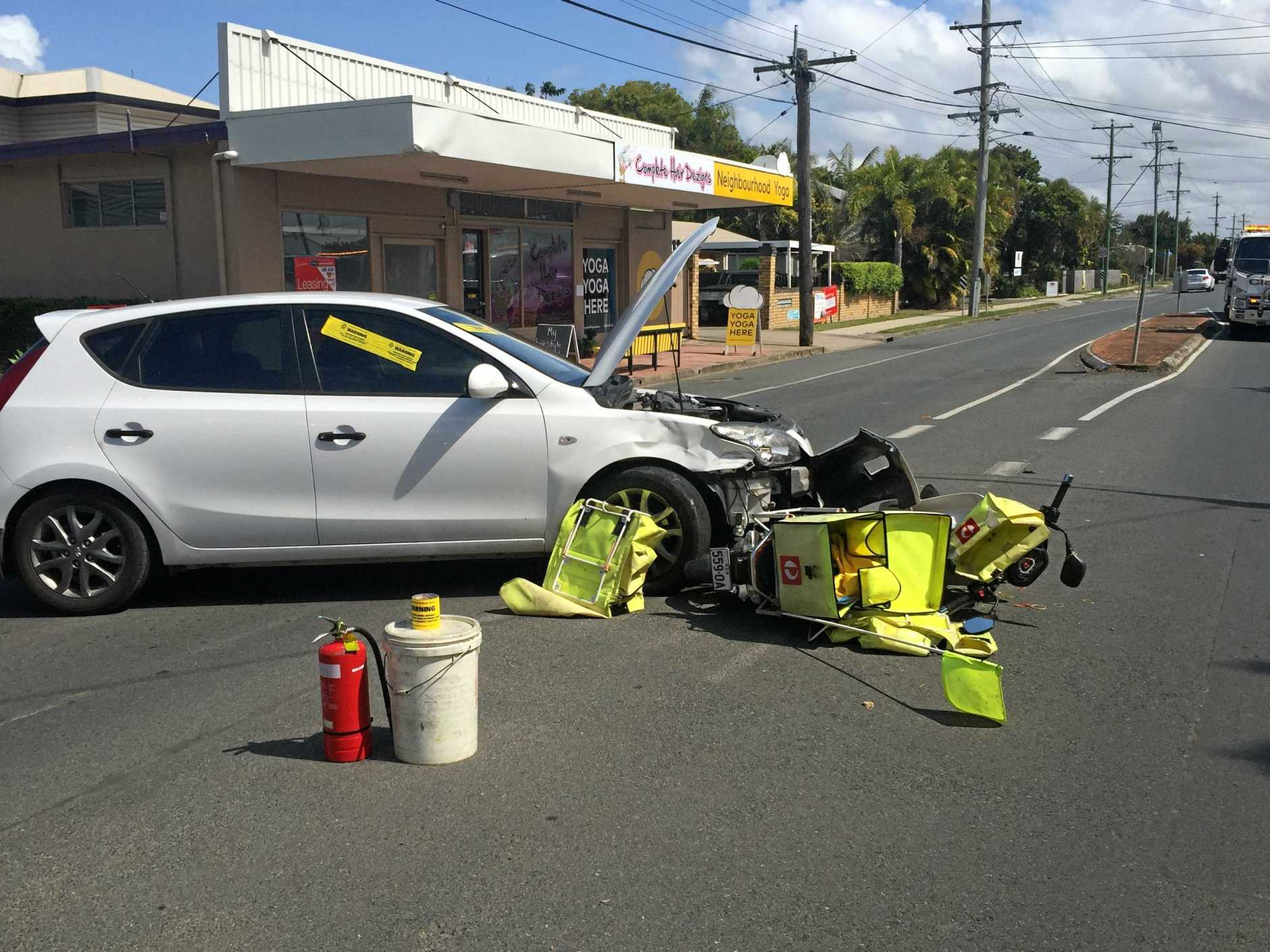 A postie was taken to hospital after this collision involving a postal delivery bike and a car in West Mackay on Wednesday.