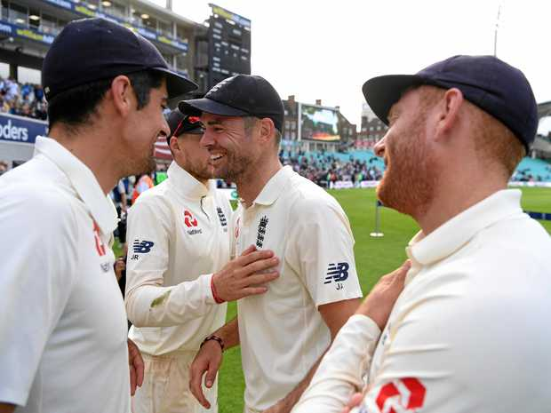 James Anderson receives the congratulations of England teammates.