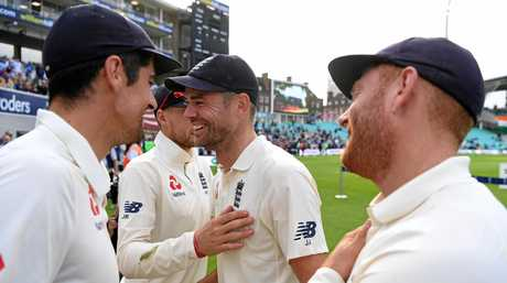 Alastair Cook, Joe Root (partly obscured), James Anderson and Jonny Bairstow enjoy the moment after England's win over India in the fifth Test match this week. Picture: Gareth Copley/Getty Images