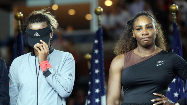 Tennis player Serena Williams competes in the women's singles finals at the 2018 U.S. Open in Flushing NY on September 8, 2018. Naomi Osaka defeated Serena Williams. 08 Sep 2018 Pictured: (L-R) Tennis players Naomi Osaka hides her face while standing next to Serena Williams during the trophy presentation ceremony at the 2018 U.S. Open in Flushing NY on September 8, 2018. (Photo by Andrew Schwartz