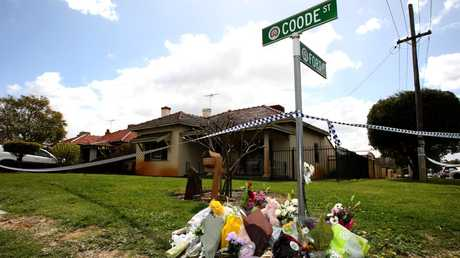 Flowers are seen outside a Perth home where five people were murdered. Picture: Richard Wainwright/AAP